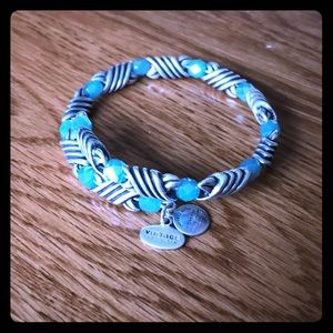 Metal and beaded Alex and Ani wrap